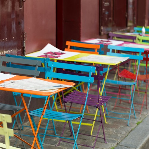 Paris - Very colorful Parisian outdoor cafe in Montmartre