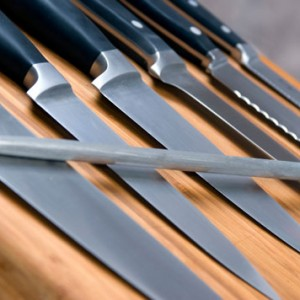 A set of high quality kitchen knives on a cutting board